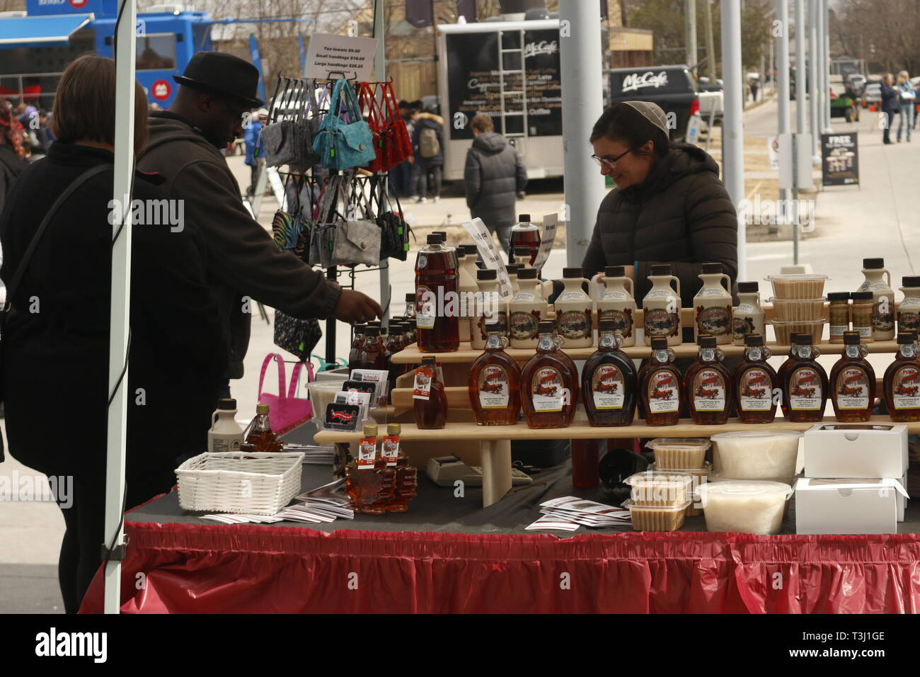 Elmira Canada, April 06 2019: Various maple syrup related goods for sale at a vendors booth. The maple syrup festival draws in visitors from around - Stock Image