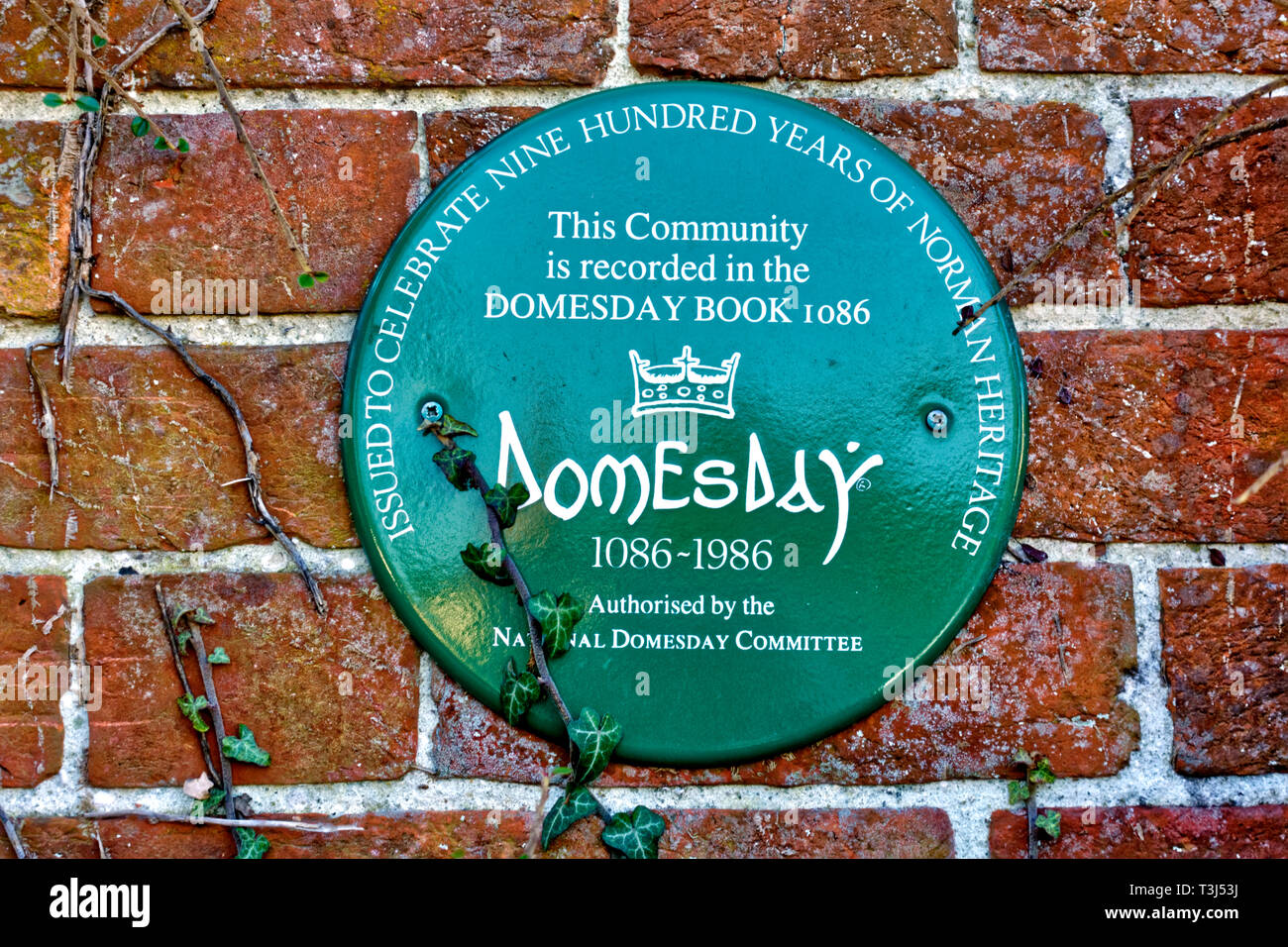 The Doomsday Plaque on the east-facing wall of the Village Hall which was once the the former school in Bishopstrow village near Warminster, Wiltshir - Stock Image