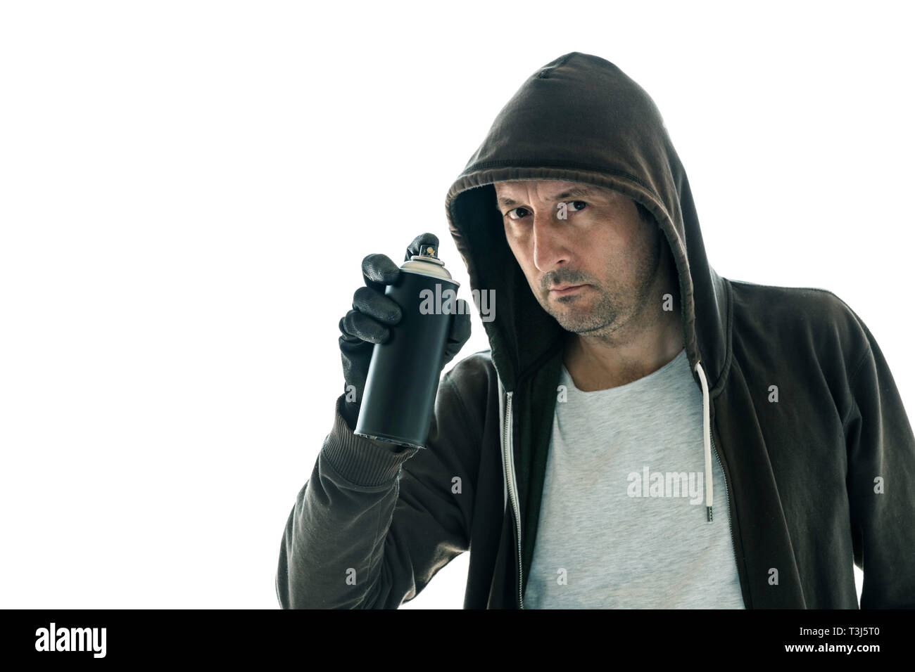 Hooded graffiti artist with spray paint can isolated on white background - Stock Image