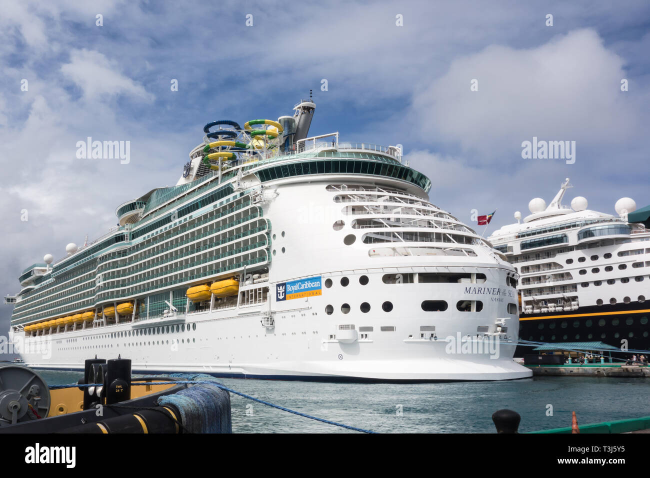 Mariner of the Seas owned by Royal Caribbean International is being docked at Nassau's cruise port terminal in Bahamas. - Stock Image