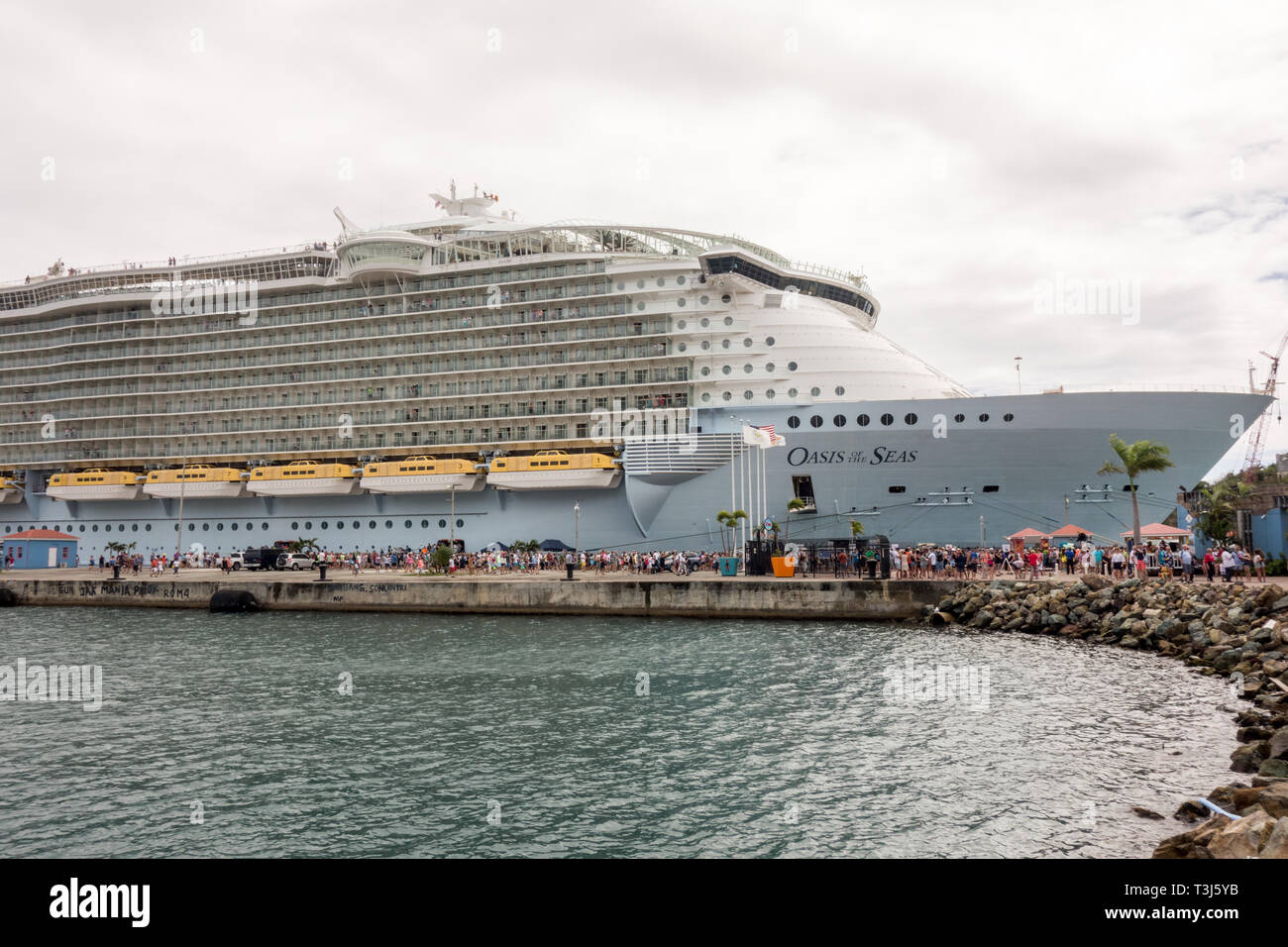 Oasis of the Seas owned by Royal Caribbean International is being docked at  St Thomas' Cruise Port. - Stock Image