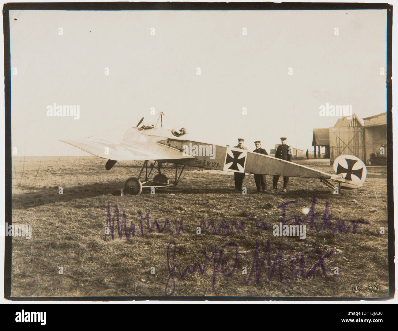 First Lieutenant Max Immelmann (1890 - 1916), a signed photo of his Fokker E IV 127/15 The Fokker with its double MG on a field in front of a hangar with Immelmann in the cockpit (8.8 x 11.4 cm). On the lower edge in purple indelible pencil 'My new Fokker - greetings, Max'. On the back in pencil 'Immelmann in his (2nd) Fokker, 160 h.p., in which he had his fatal accident on 18th June.' The Fokker E IV was developed in 1915, but only came into use at the front in April 1916, the delay was due to a faulty MG synchronising gear. Immelmann however di, Additional-Rights-Clearance-Info-Not-Available - Stock Image