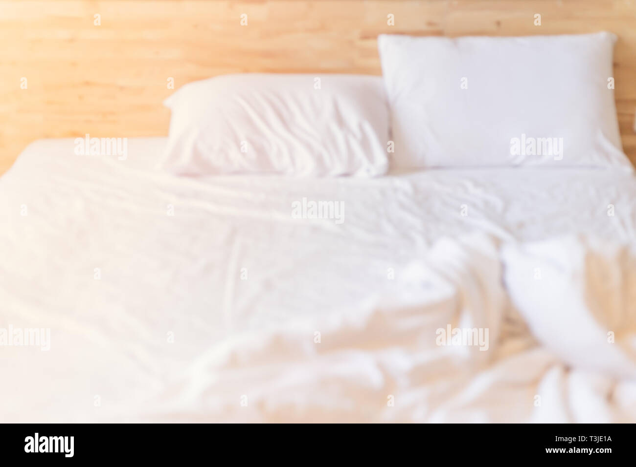blur morning white clean messy bed for background - Stock Image
