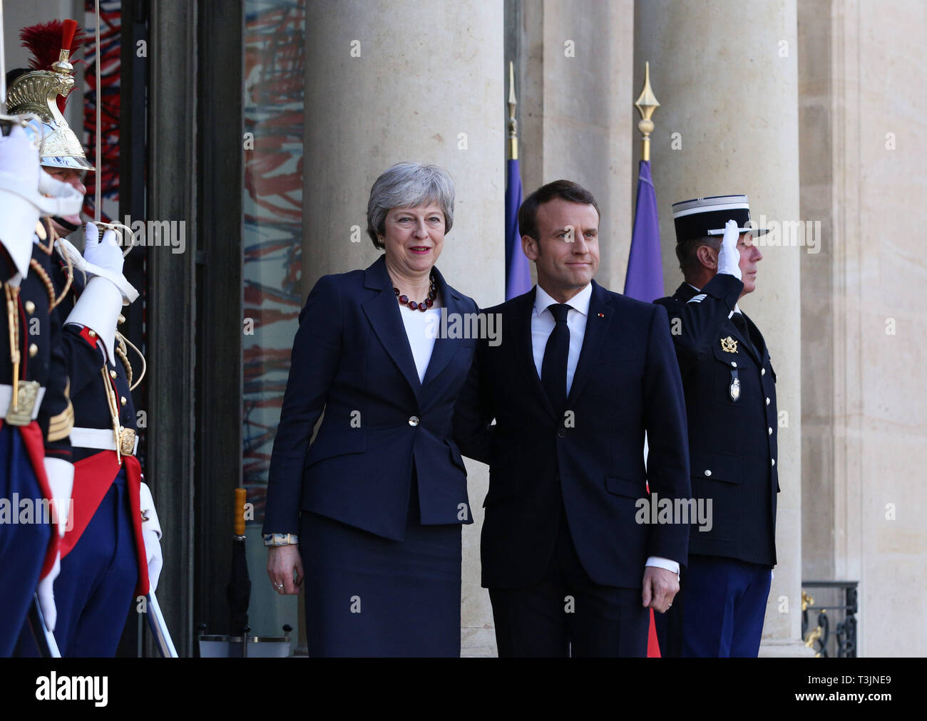 Paris, France. 9th Apr, 2019. French President Emmanuel Macron (R, front) welcomes visiting British Prime Minister Theresa May at the Elysee Palace in Paris, France, April 9, 2019. May held talks in Berlin with German Chancellor Angela Merkel and in Paris with French President Emmanuel Macron during a day of whistle-stop diplomacy in her race to win a delay to the country's departure from the European Union (EU). Credit: Gao Jing/Xinhua/Alamy Live News - Stock Image