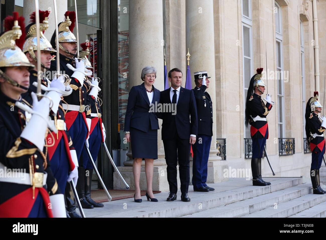 Paris, France. 9th Apr, 2019. French President Emmanuel Macron welcomes visiting British Prime Minister Theresa May at the Elysee Palace in Paris, France, April 9, 2019. May held talks in Berlin with German Chancellor Angela Merkel and in Paris with French President Emmanuel Macron during a day of whistle-stop diplomacy in her race to win a delay to the country's departure from the European Union (EU). Credit: Gao Jing/Xinhua/Alamy Live News - Stock Image