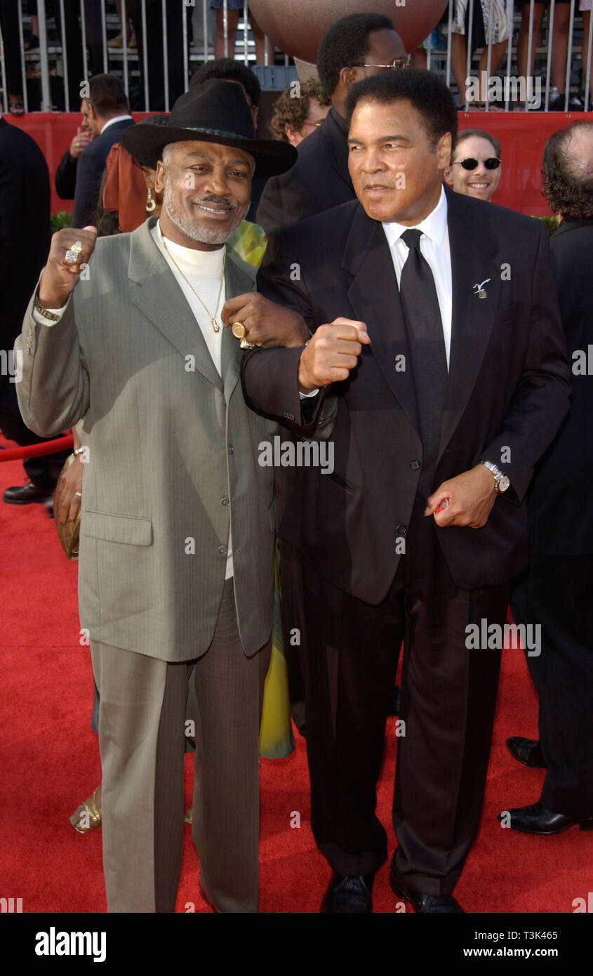 LOS ANGELES, CA. July 10, 2002: Former boxers MUHAMMAD ALI (right) & JOE FRAZIER at the 10th Annual ESPY Sports Awards in Hollywood. © Paul Smith / Featureflash Stock Photo