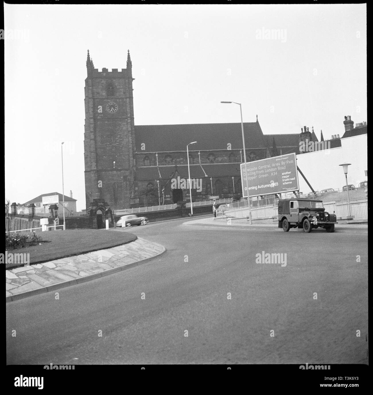 Church Street, Newcastle-under-Lyme, Staffordshire, 1965-1968. St Giles' Church viewed from the south-west with the newly constructed roundabout associated with the Newcastle Central Area Bypass in the foreground. - Stock Image