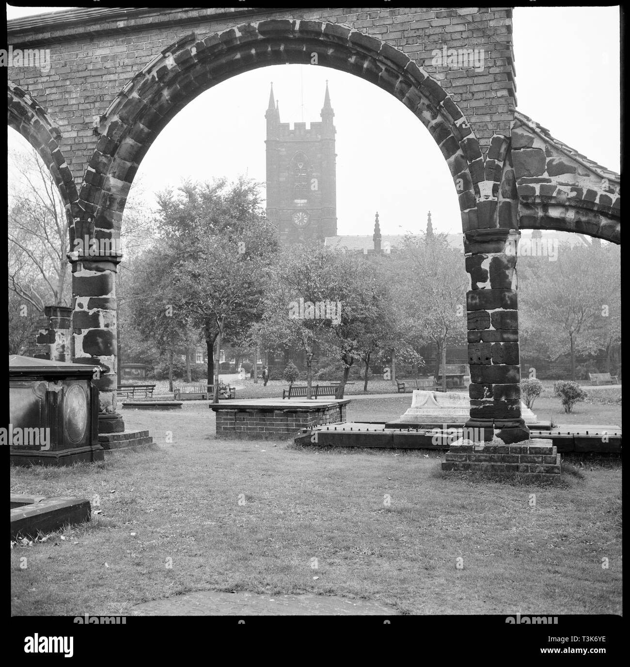 St Peter's Church, Glebe Street, Stoke-upon-Trent, 1965-1968. View of the church seen through the re-erected stone arches of the former church. St Peter's, also known as Stoke Minster, is the historic and civic church for the City of Stoke-on-Trent. By the 1820s the existing medieval church had become too small for the growing congregation and in 1830 the new Church of St Peter ad Vincula was consecrated. In the late 19th century some of the stones from the former church were reconstructed to represent the south arcade of the nave. - Stock Image