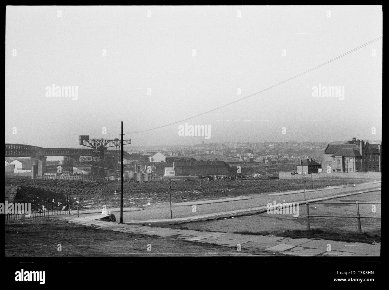 Deptford Terrace, Deptford, Sunderland, 1961. Cleared land on Deptford Terrace viewed from Deptford Junction with Queen Alexandra Bridge to the left of frame and Deptford Terrace School to the right. This is one of a group of photographs associated with the Pyrex factory (Wear Flint Glass Works, manufacturers of Pyrex in the UK. - Stock Image