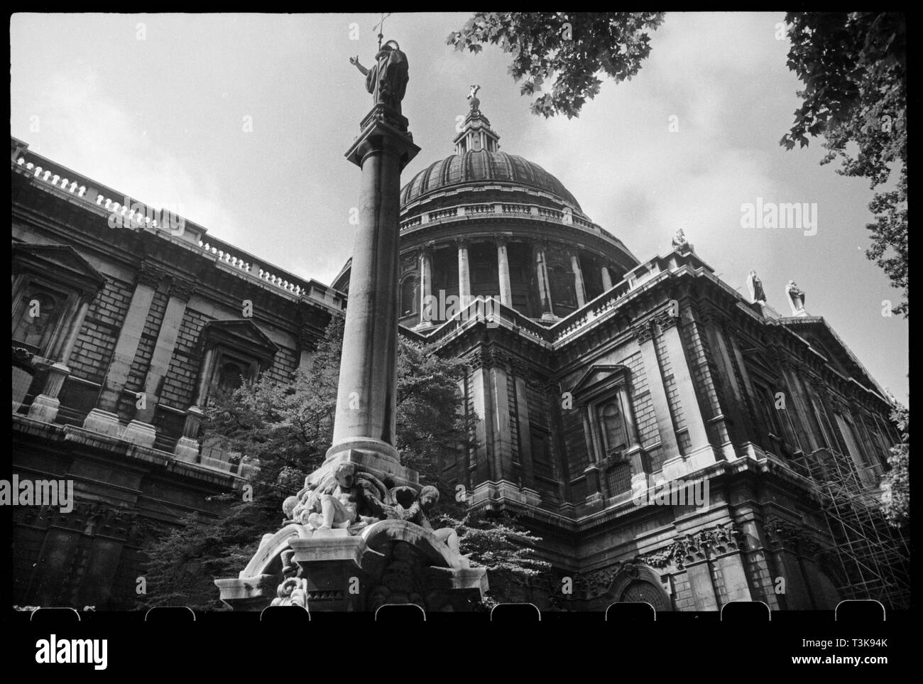 St Paul's Cathedral, City of London, c1955-c1980. Exterior view of St Paul's Cathedral, showing a view of the dome roof, seen from the north-east with St Paul's Cross in the foreground. St Paul's Cathedral was built in the classical style with mostly Portland stone between 1675-1710 by Sir Christopher Wren to replace the previous medieval cathedral that had burnt in the Great Fire of London. The image shows the north elevation, with transept on the right, topped with a wide pediment. Over the pediment are a number of statues, four of which can be seen from the ground. The central domed roof, p - Stock Image