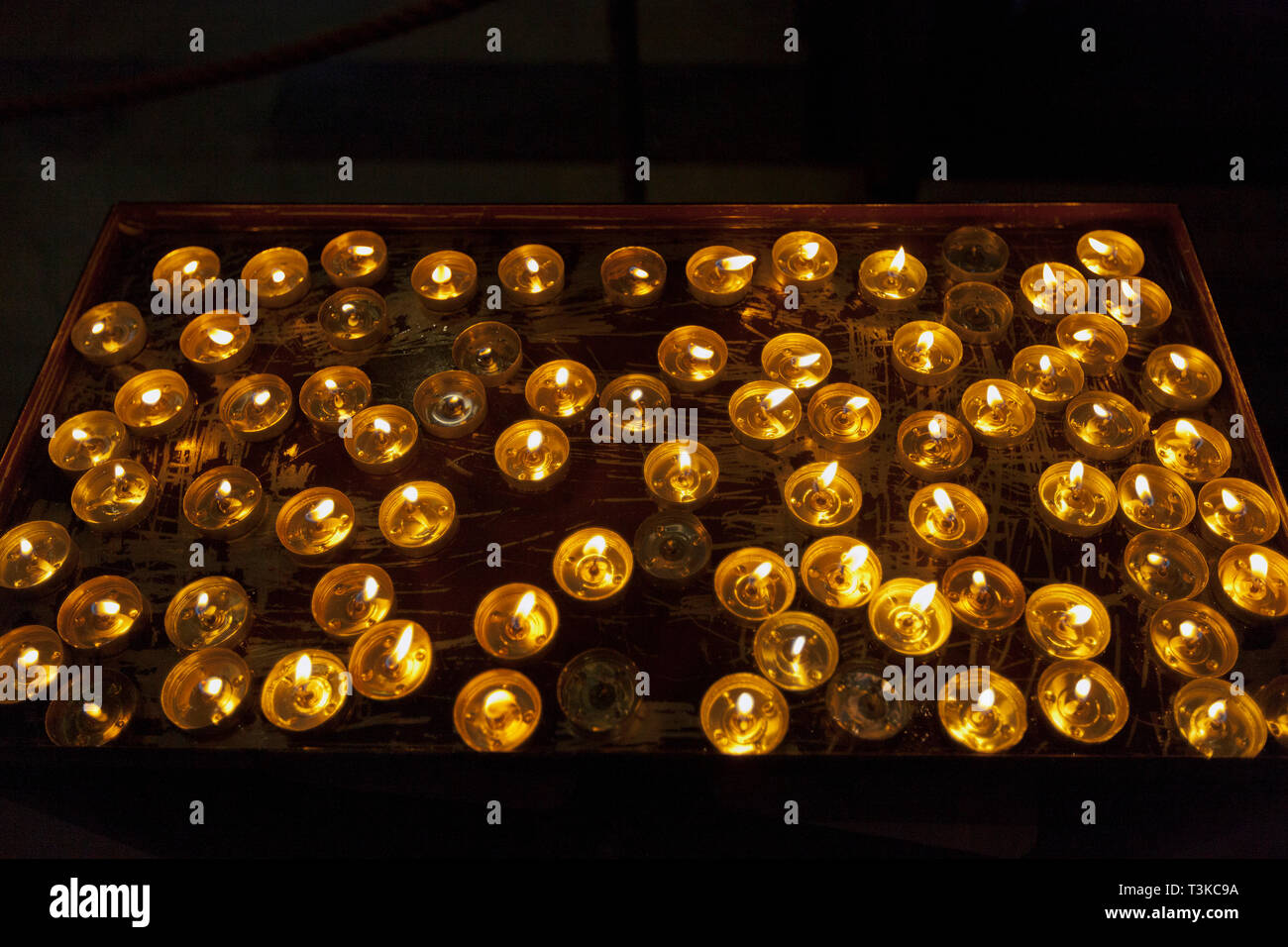 Votive candles, Pisa Cathedral Stock Photo