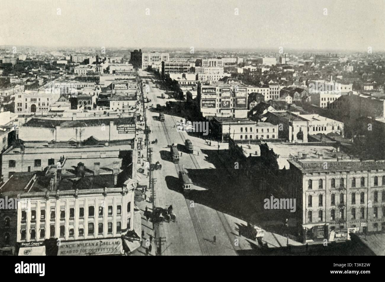 'Winnipeg To-Day; Looking Up Main Street. - The Rapid Growth of Modern Canada', c1930. Creator: Valentine & Sons Ltd. - Stock Image