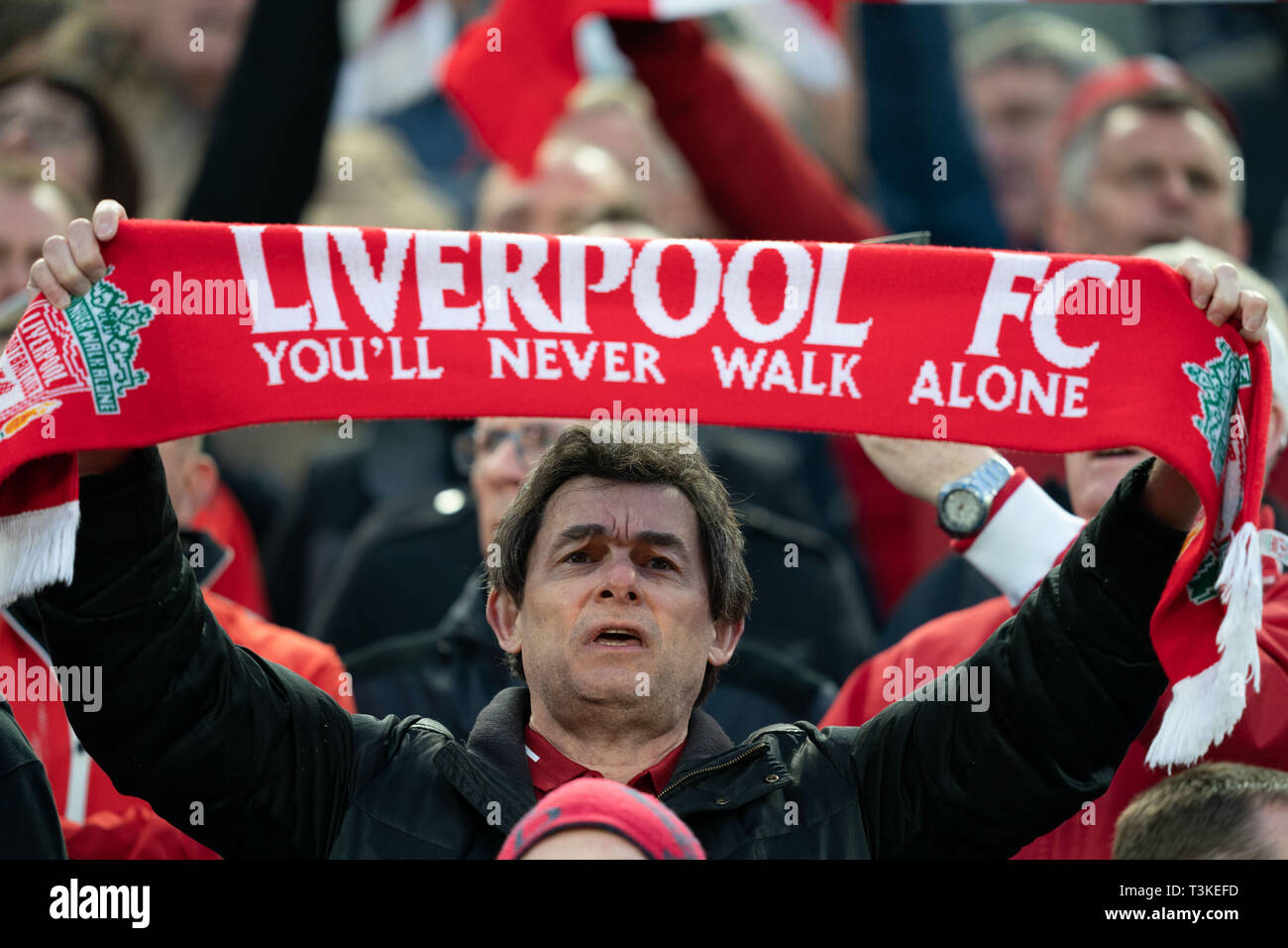 Fan holds a scarf above his head 9th April 2019 , Anfield