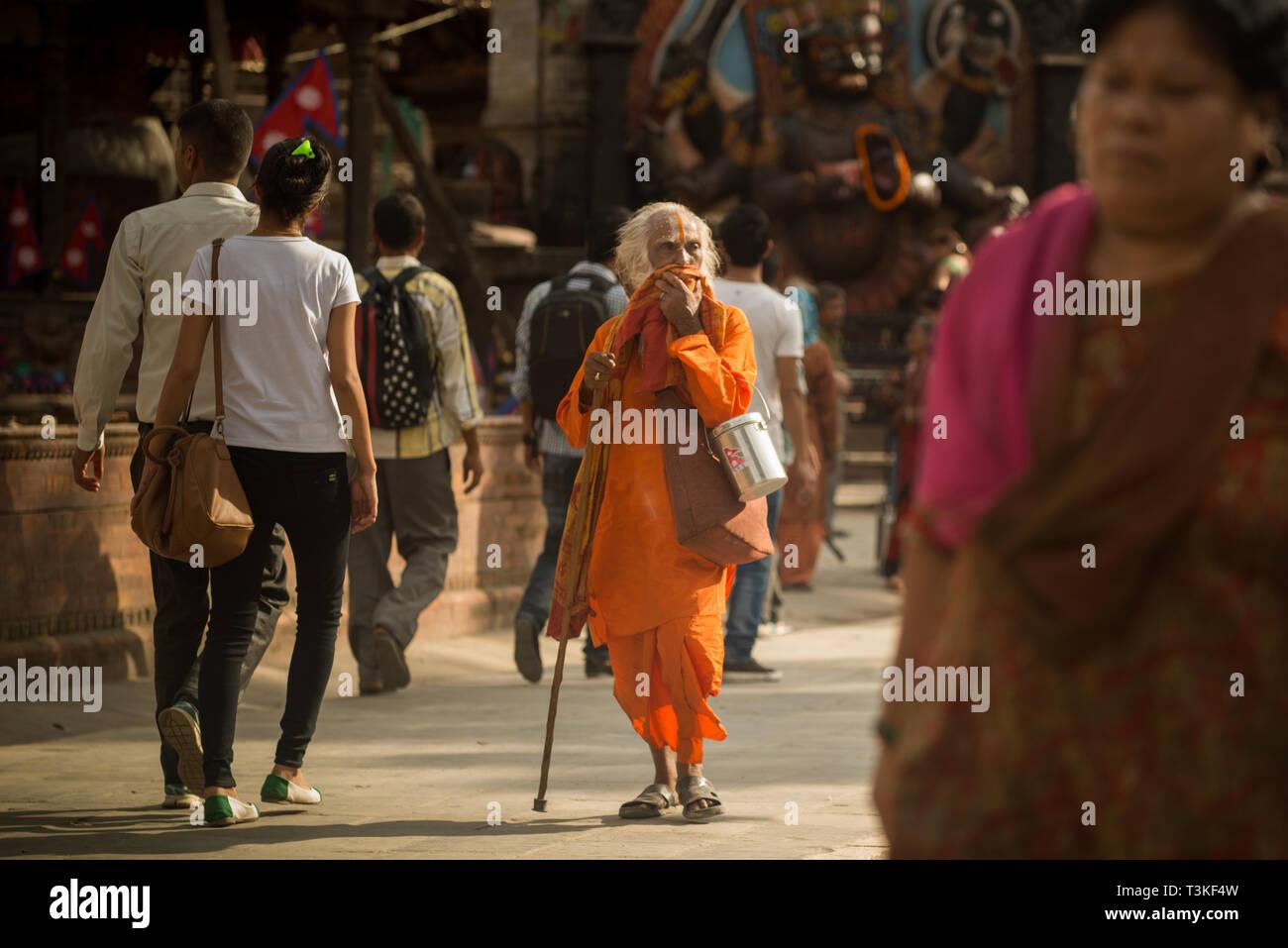 Sadhu walking in the street - Stock Image