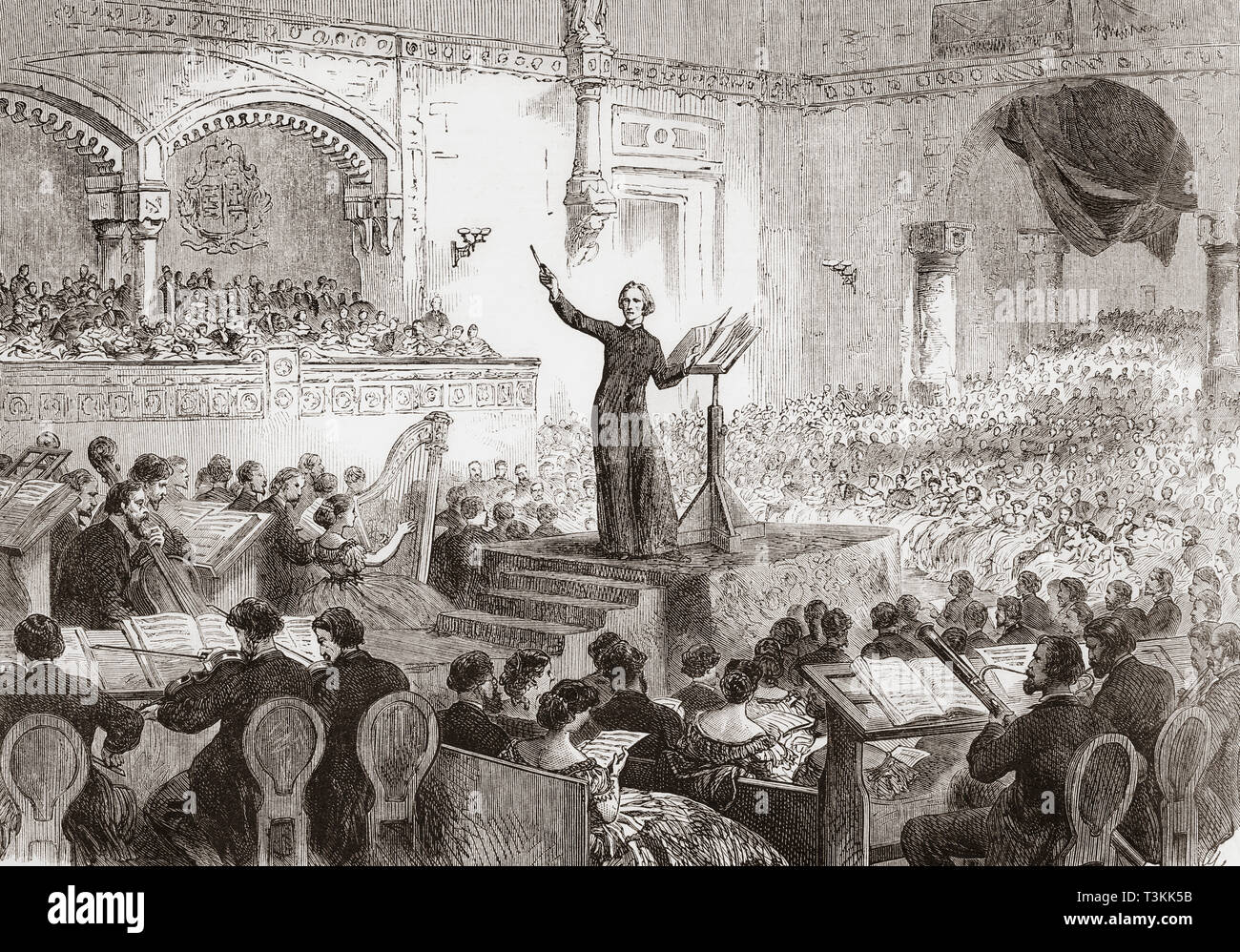 Franz Liszt conducting the performance of his new oratorio, The Legend of St. Elizabeth, in Pest, Hungary in 1865. Franz Liszt, 1811 – 1886.  Hungarian composer, virtuoso pianist, conductor, music teacher, arranger, organist, writer, philanthropist,  Hungarian nationalist and a Franciscan tertiary.  From The Illustrated London News, published 1865. - Stock Image