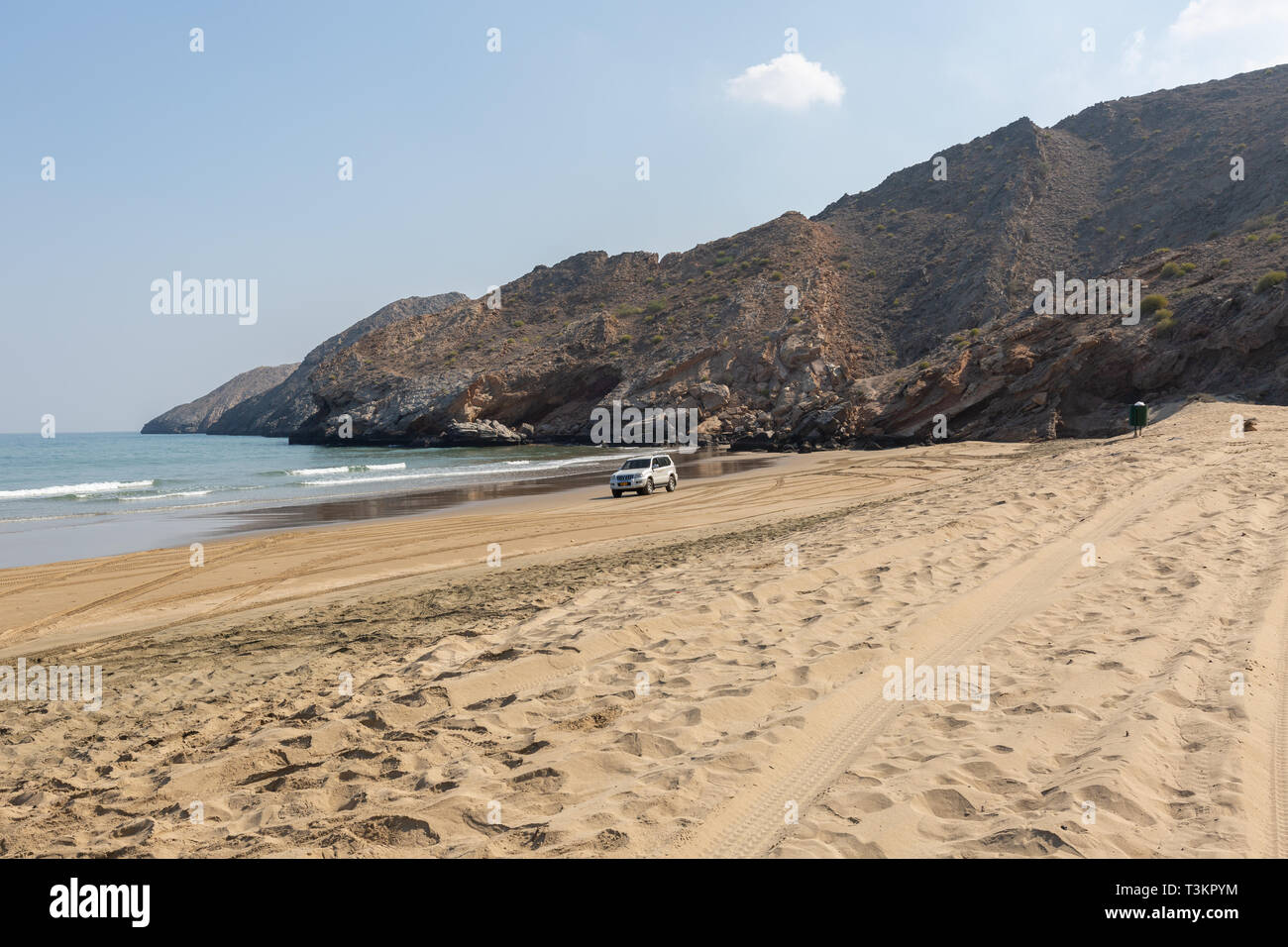 Empty Yiti Beach in a summer morning tire tracks on the sand near Muscat - Sultanate of Oman - Stock Image