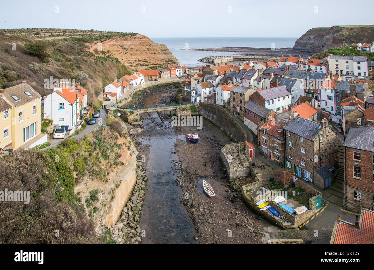 A classic view of Staithes at low tide, Staithes is a a traditional fishing village and seaside resort on the North Yorkshire coast, England UK. - Stock Image
