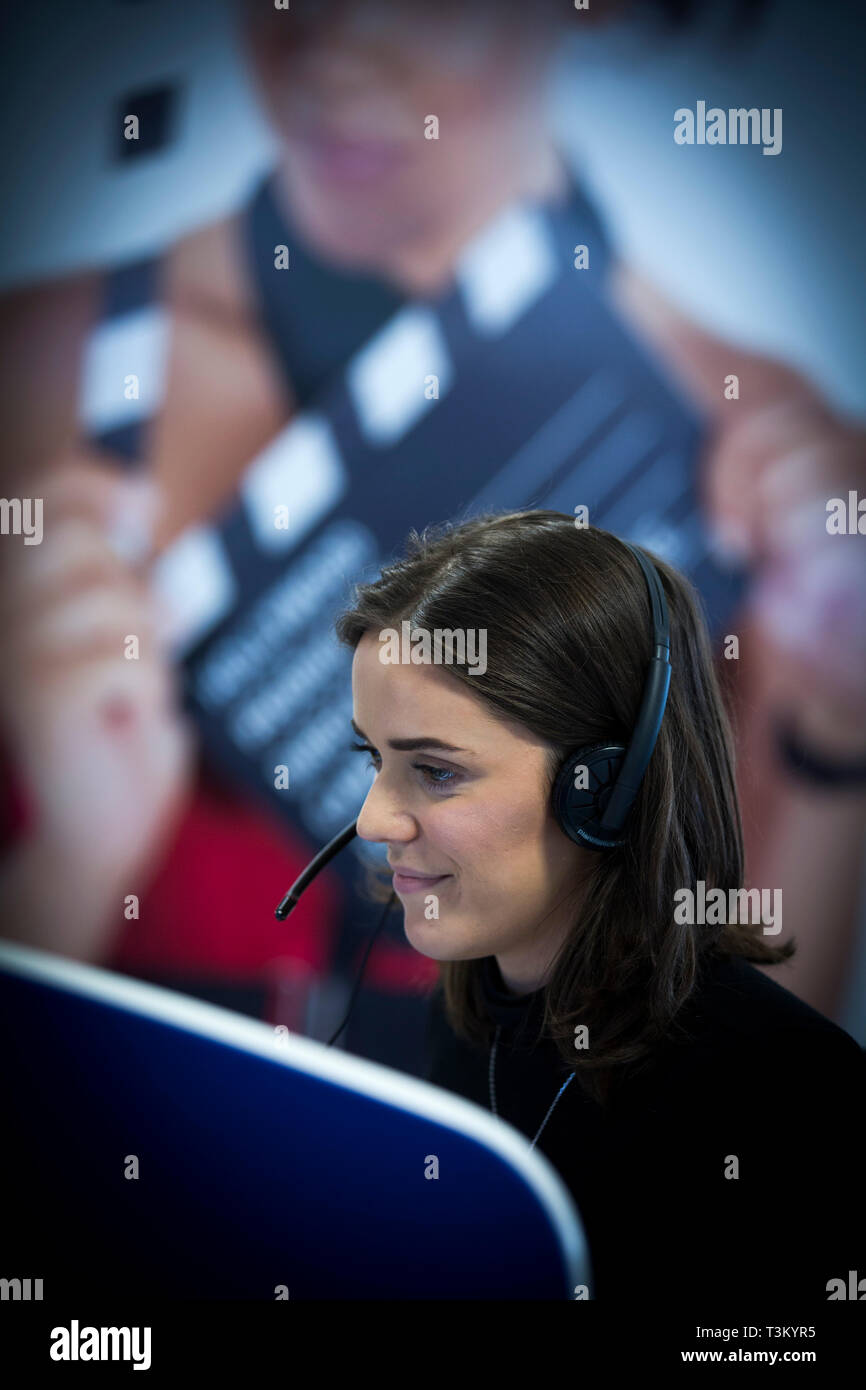 Lucy Mason, a member of staff working in the RSVP Manchester call centre. The company employs people in acting and entertainment management to take calls at their offices in Salford Quays, Manchester. The company opened the office in October, 2016. - Stock Image