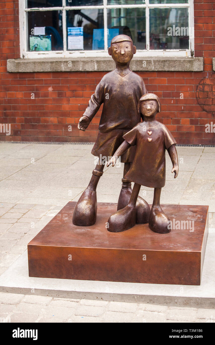 The new statue by artist, Mackenzie Thorpe, entitled 'Waiting for me Dad' was unveiled next to the Transporter Bridge,Middlesbrough on 9th April 2019. - Stock Image