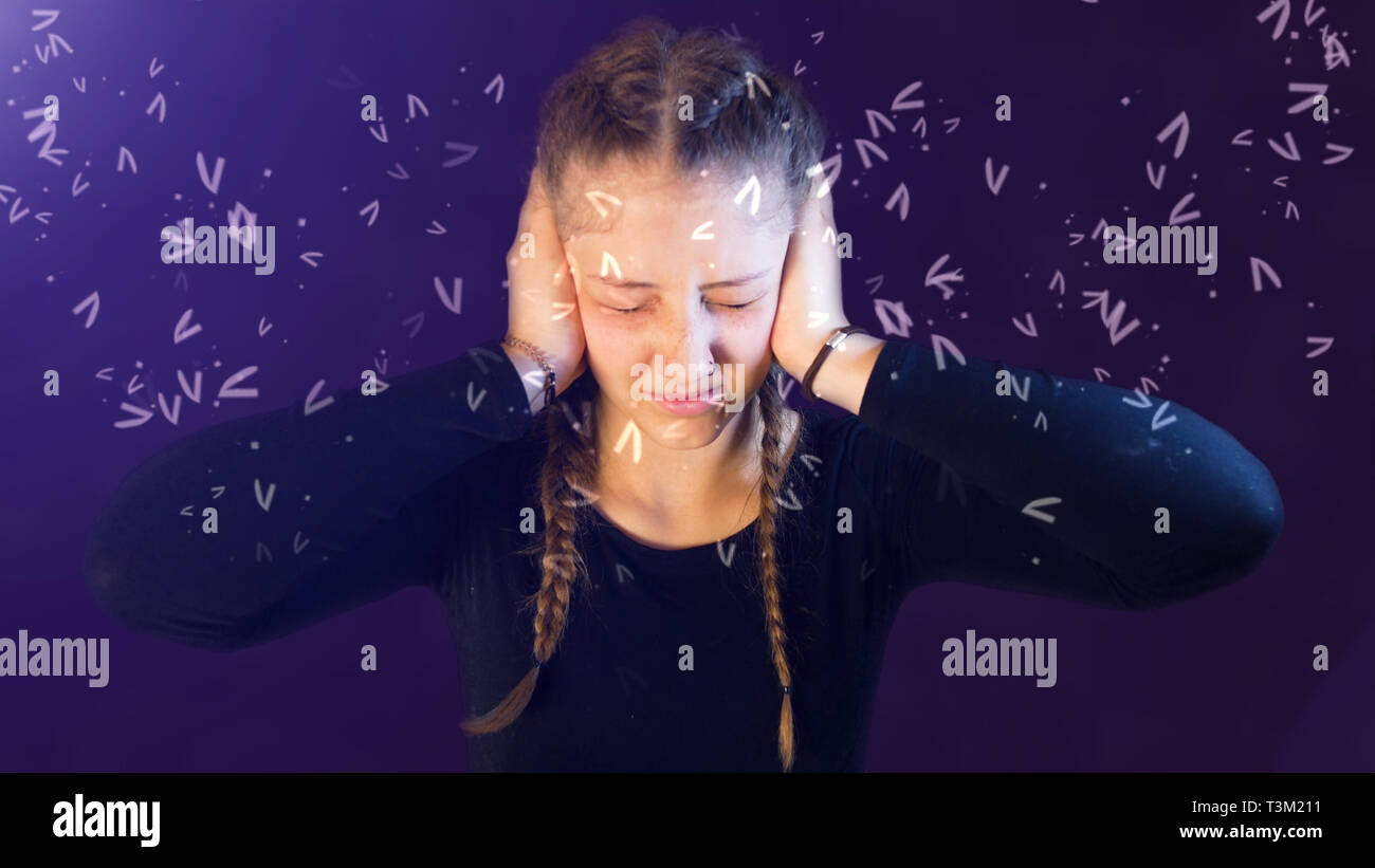 Teenage girl dressed casual with pigtails, being attacked by social media, creating emotional stress - Stock Image