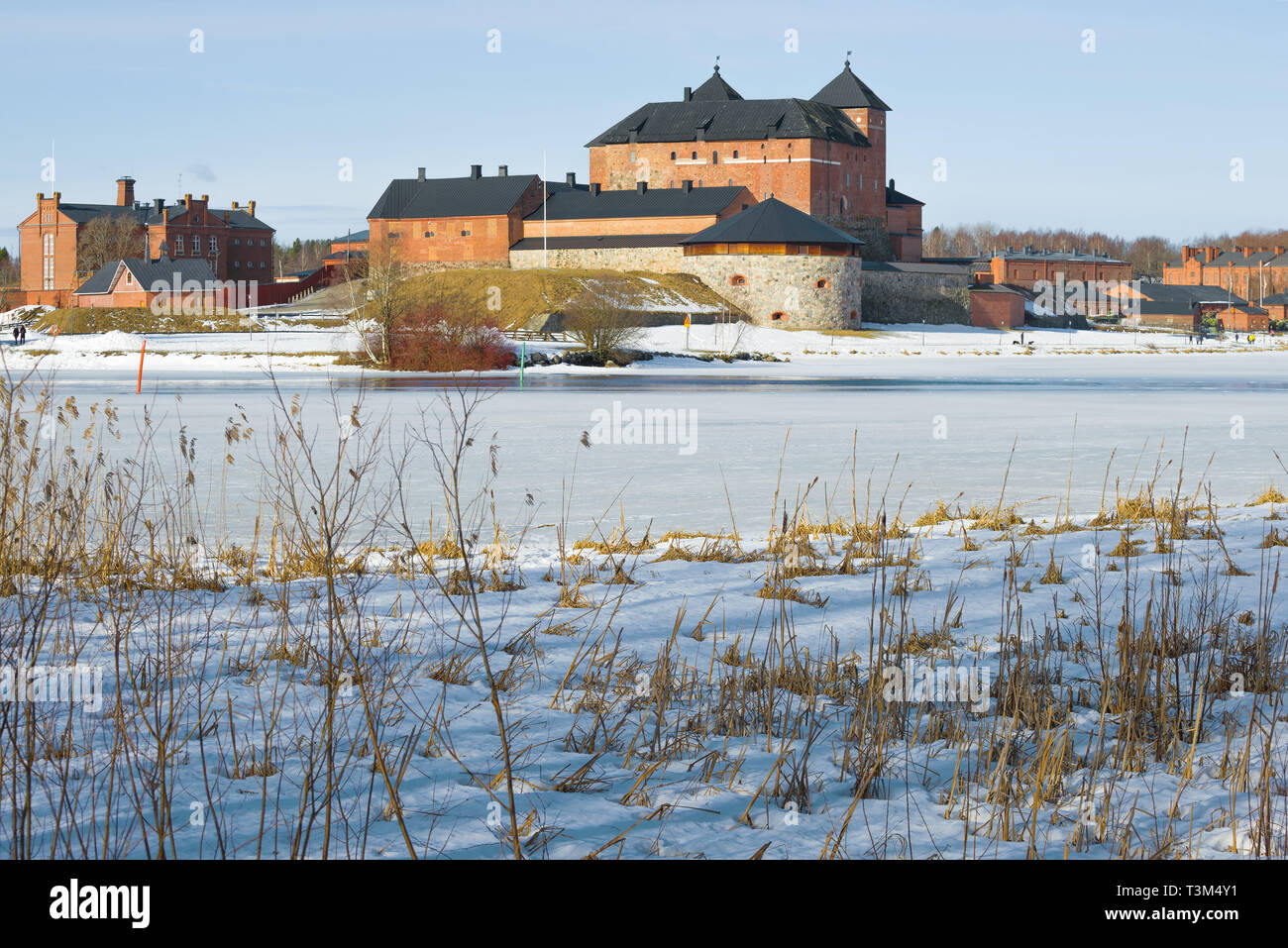 The old fortress-prison on the shores of Vanajavesi lake on a March afternoon. Hameenlinna, Finland Stock Photo