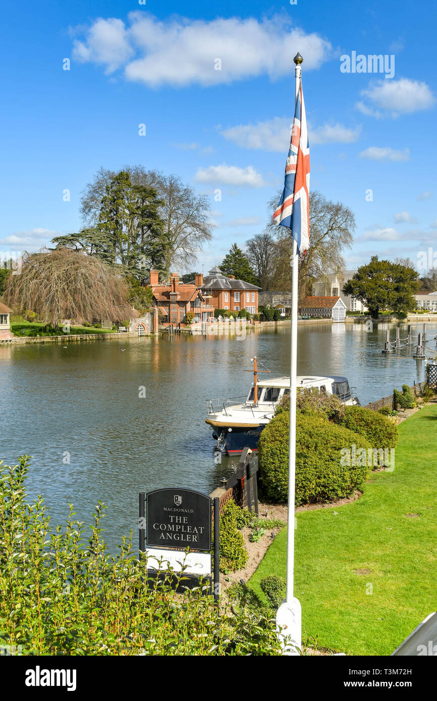 MARLOW, ENGLAND - MARCH 2019: Sign and flag pole outside The Compleat Angler hotel on the banks of the River Thames in Marlow. Stock Photo