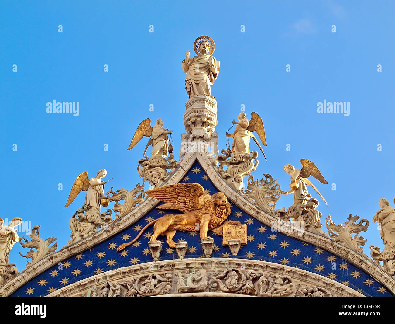 Sculptures on the top of st mark basilica in Venice - Stock Image
