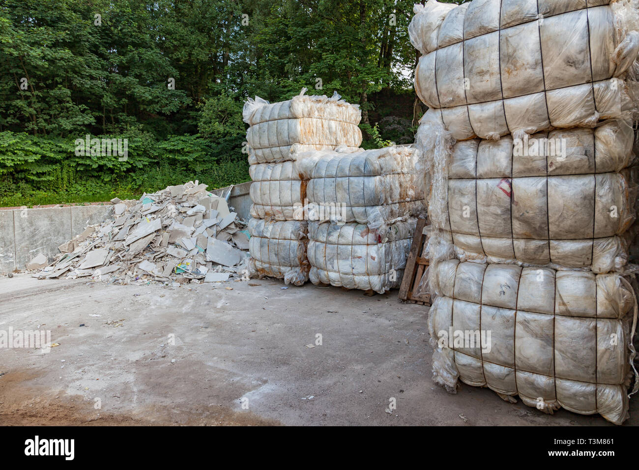 Bundle / cube with plastic garbage on a recycling yard - Stock Image