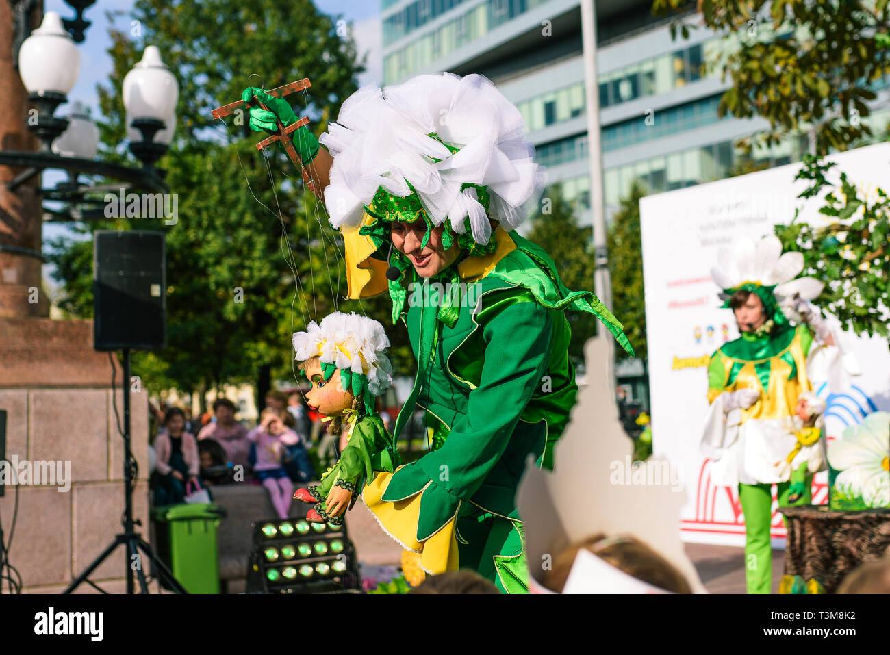 Russia, city Moscow - September 6, 2014: The puppet theater actor controls the doll. A doll driven by a puppeteer actor with the help of threads - Stock Image