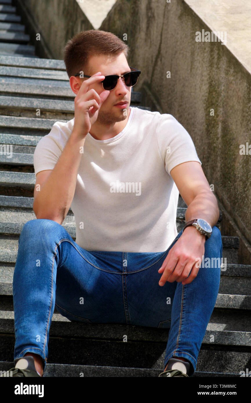 Man Sitting Alone On Steps Handsome Boy With Sunglasses Male Model Posing For Shooting Sitting On Old Stairs Portrait Of Cool Guy Sitting Stock Photo Alamy