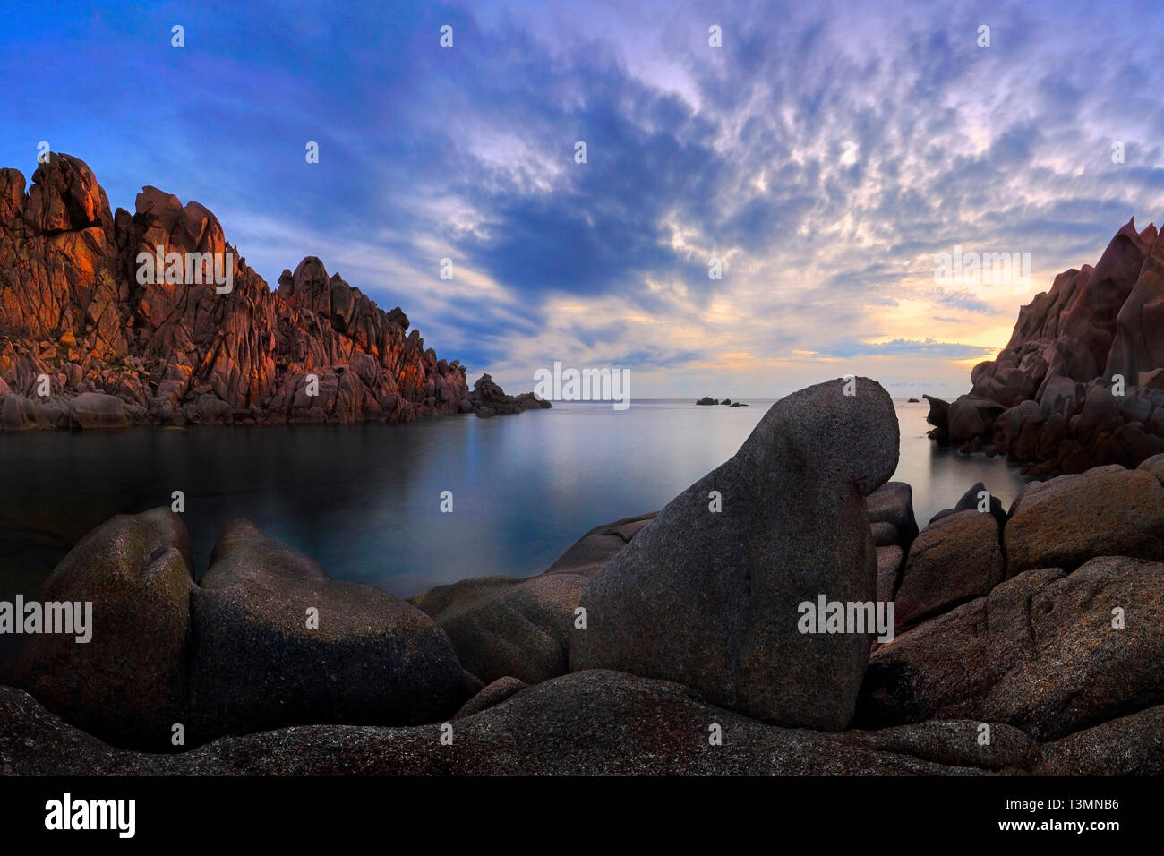 A view at dusk of some wonderful granite and sandstone rocky formations carved into surreal shapes by the action of winds and waves. This is Valle del Stock Photo