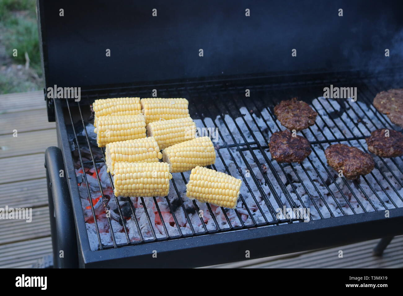 corn on the cob and kebabs on barbecue grill Stock Photo