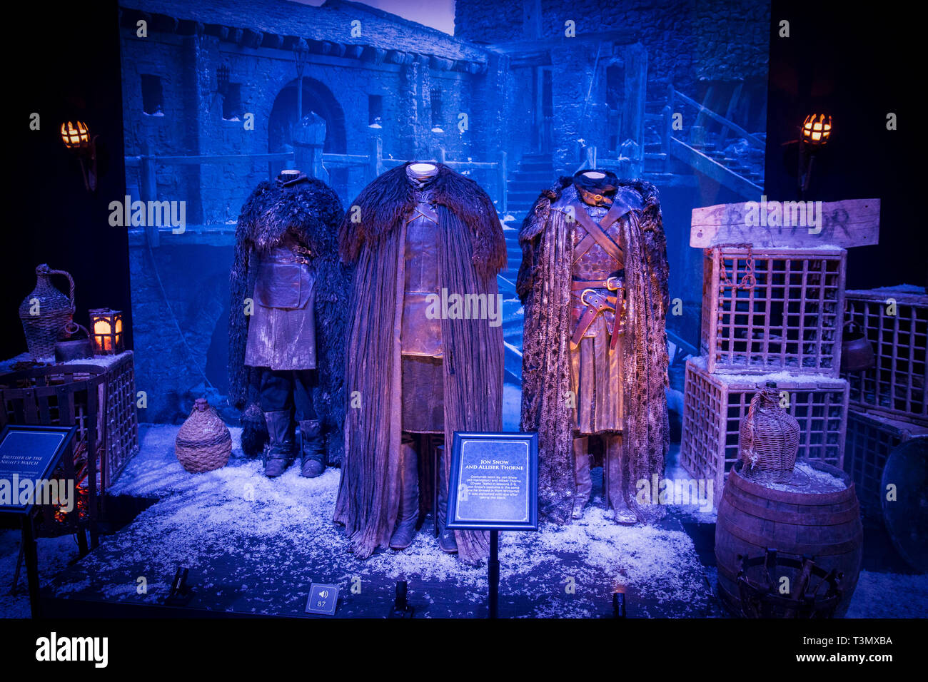 Costumes worn by the character Jon Snow, played by Kit Harington, and the character Alliser Thorne played, by Owen Teale, on display at the launch of the Game of Thrones touring exhibition at the Titanic Exhibition Centre in Belfast. - Stock Image