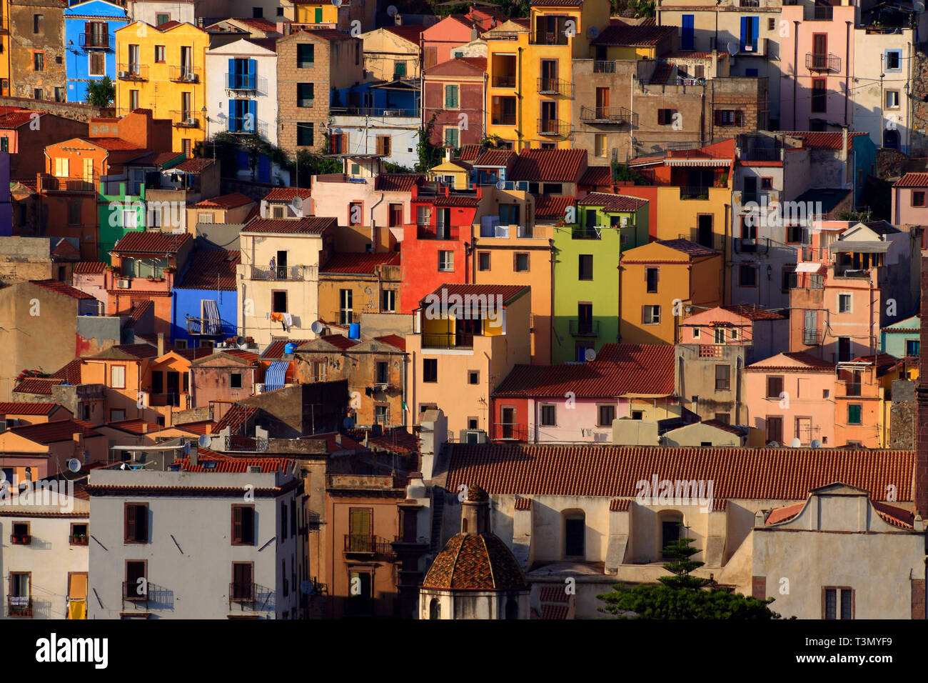 The crazy colours of the houses of Bosa, a charming town on the shores of Temo river and along the western coast of Sardinia, half way between Alghero - Stock Image