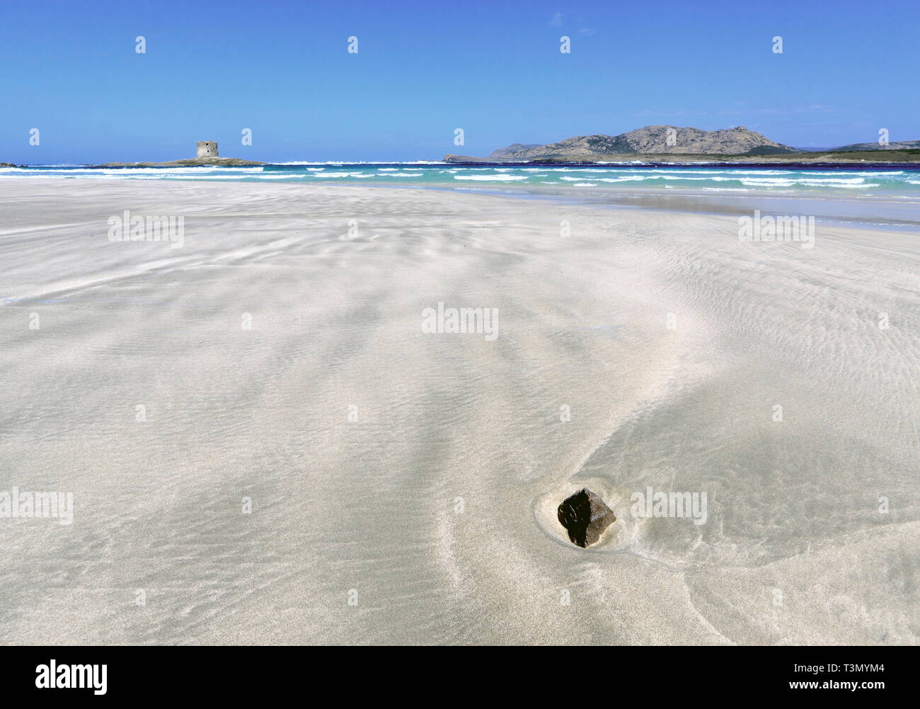 A mid-day view of the wonderful, tropical-like beach of La Pelosa nearby Stintino in Sardinia, Italy, with the XVI century Genovese watch tower and th - Stock Image