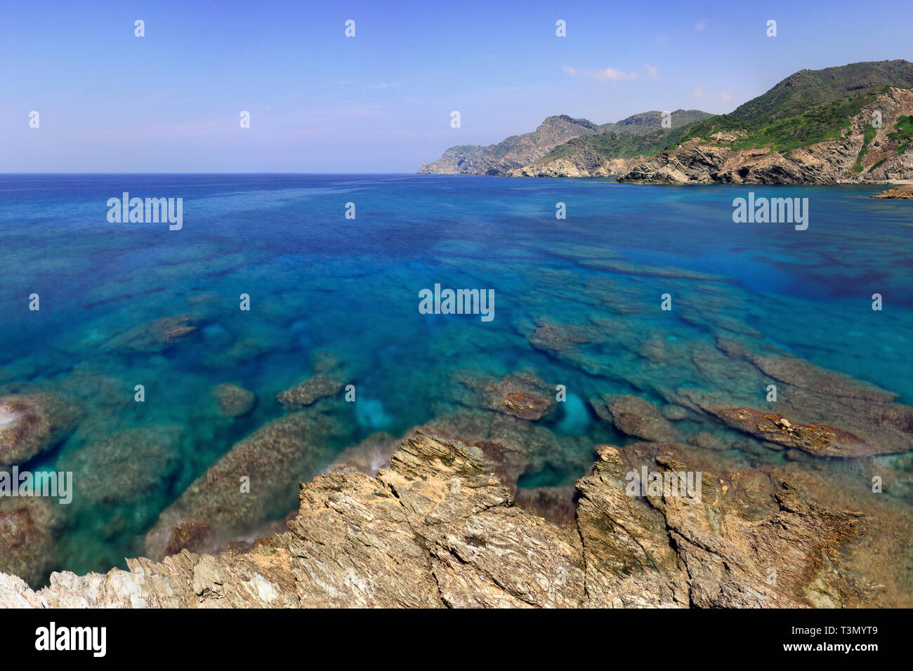 The rocky coast nearby Porticciolo, a small hamlet along the western coast of Sardinia, not far from Capo Caccia and Alghero - Stock Image
