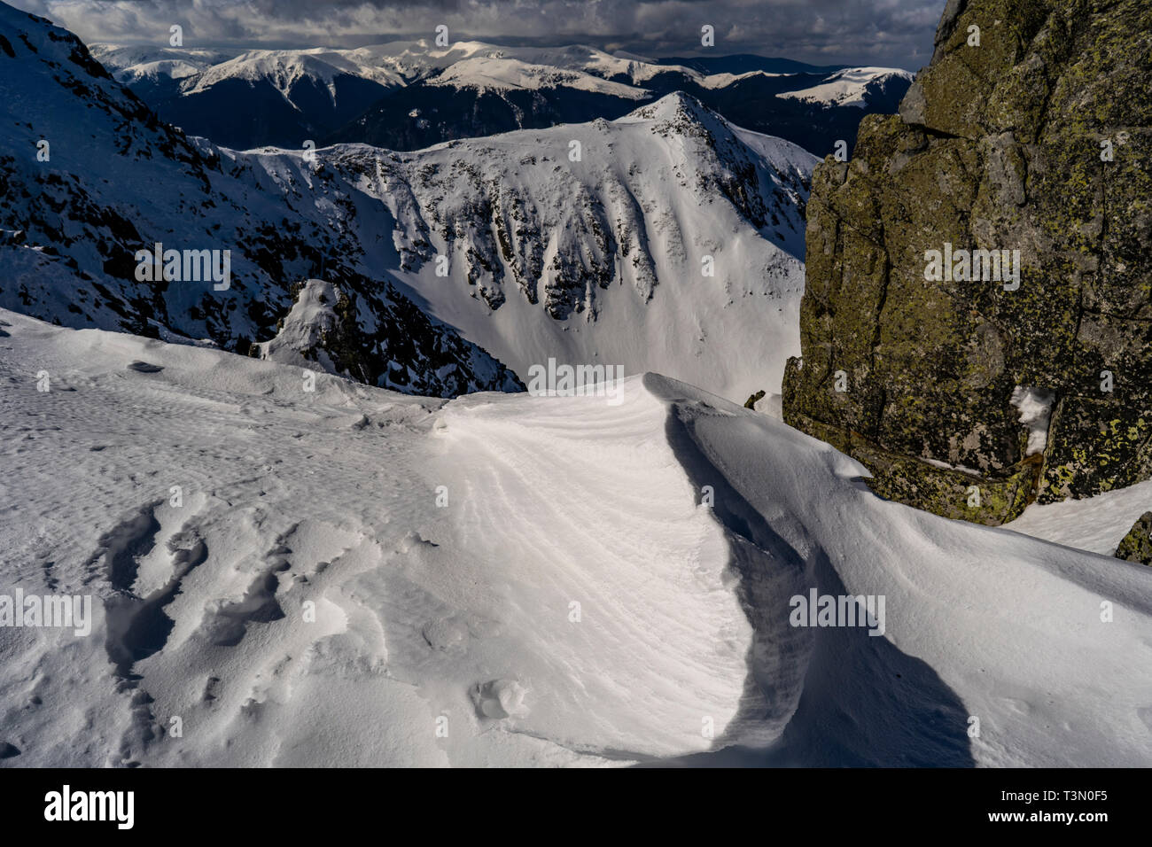 Group of mountaineers ascend and reach the top of one of the most spectacular peaks in Retezat National Park, Romania Stock Photo