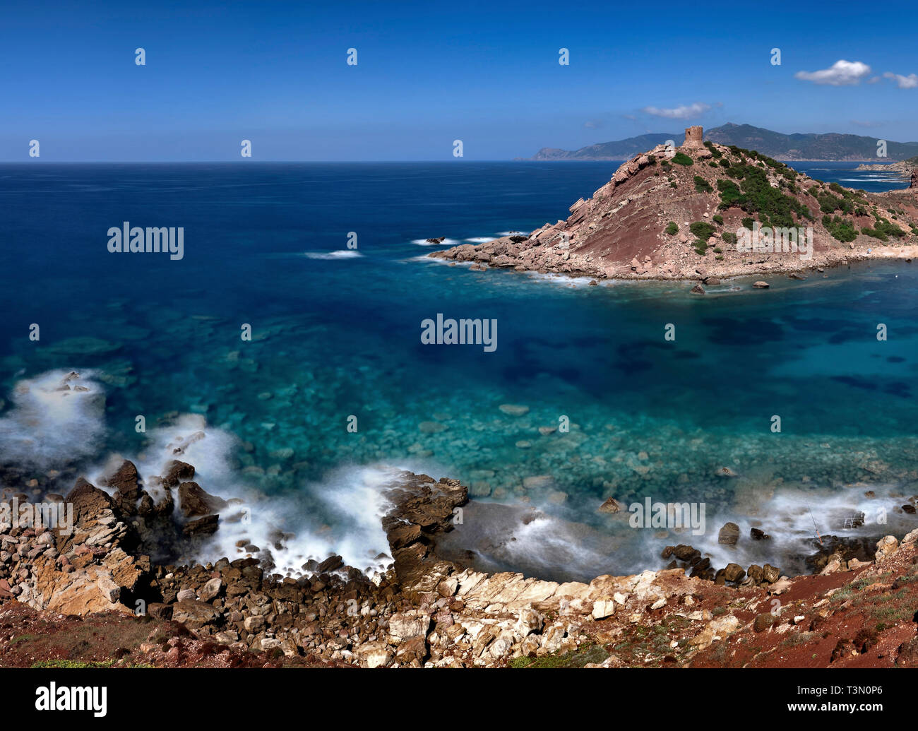 The medieval watch tower of Porticciolo, a small hamlet along the western coast of Sardinia, not far from Capo Caccia and Alghero - Stock Image