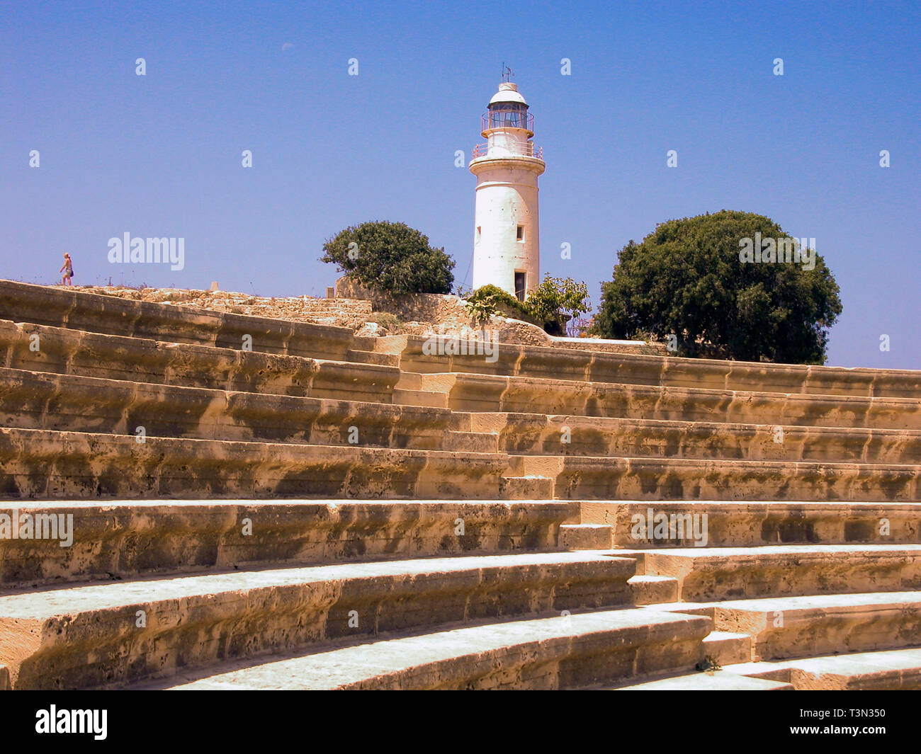 Roman odeion, restored 1970's, and lighthouse, Kato Pafos, Cyprus Stock Photo