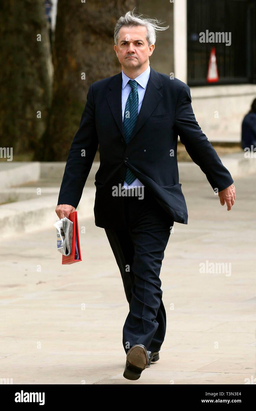 Chris Huhne MP walking along Whitehall. London. 16.5.2011. - Stock Image