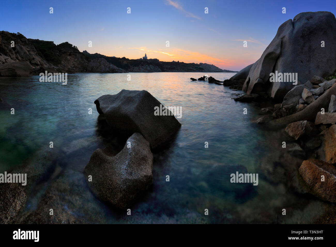 The amazing wind carved rocky sculptures at the beach of Cala Spinosa,a beautiful small bay surrounded by huge granite rocks at Capo Testa in the nort - Stock Image