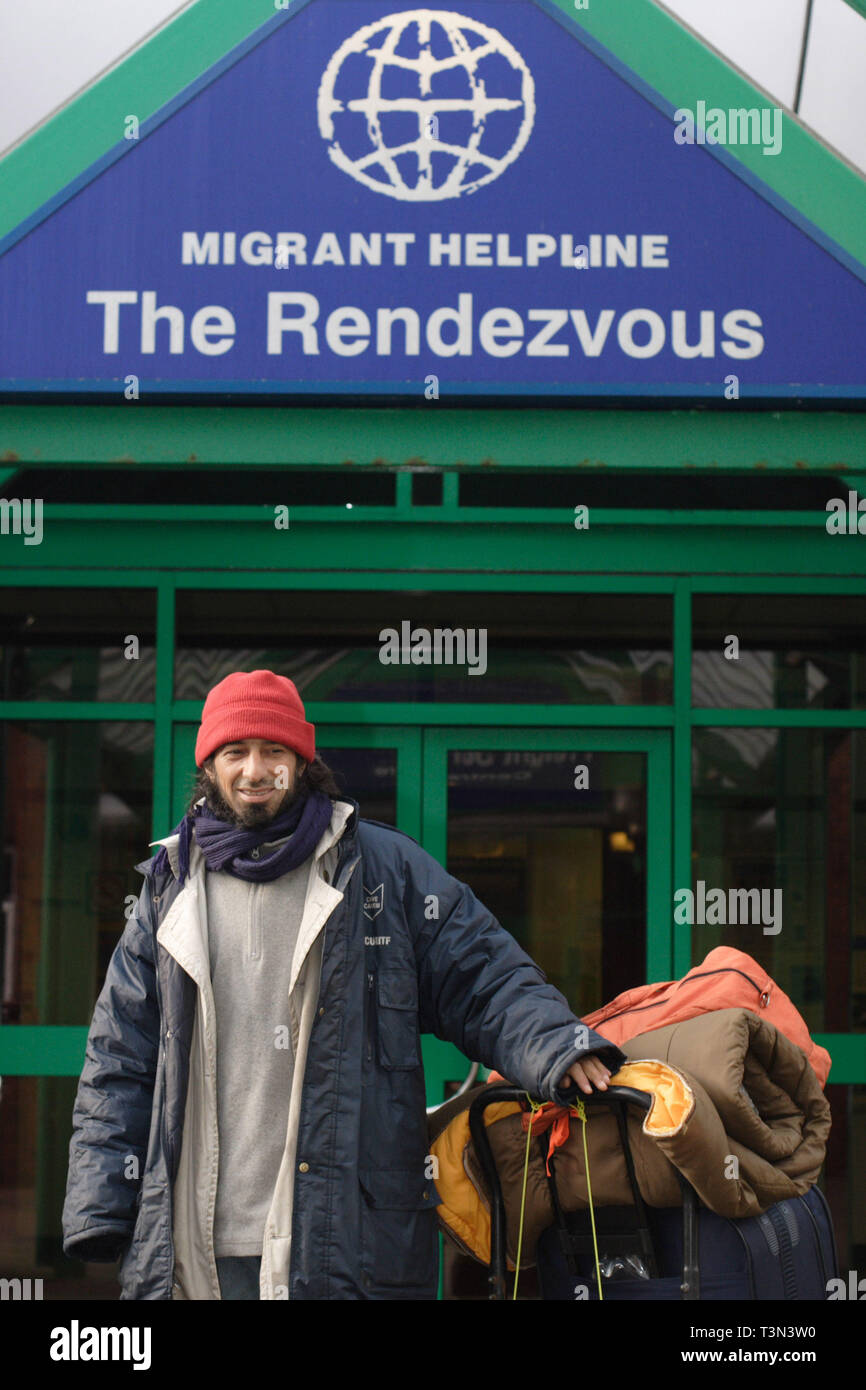 An asylum sleeping rough in Dover poses outside Migrant Helpline, Dover. 06/12/2005 - Stock Image