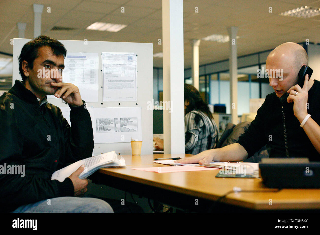 Newly arrived refugee sits waiting as he is assess his asylum in the UK. Migrant Helpline, Dover. 06/12/2005 - Stock Image