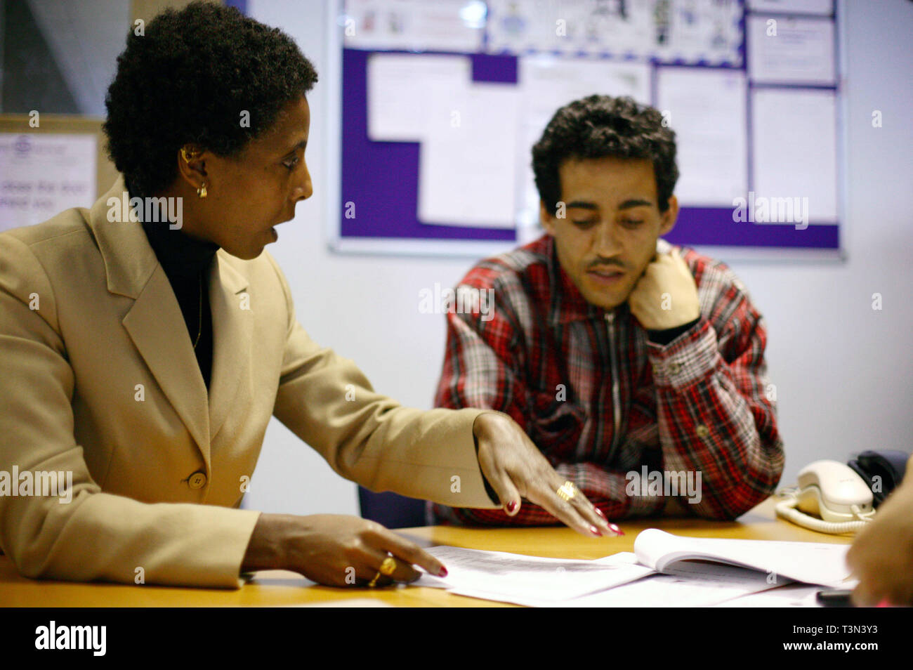Newly arrived refugee speaks through interpreter during interview to assess his asylum in the UK. Migrant Helpline, Dover. 06/12/2005 - Stock Image