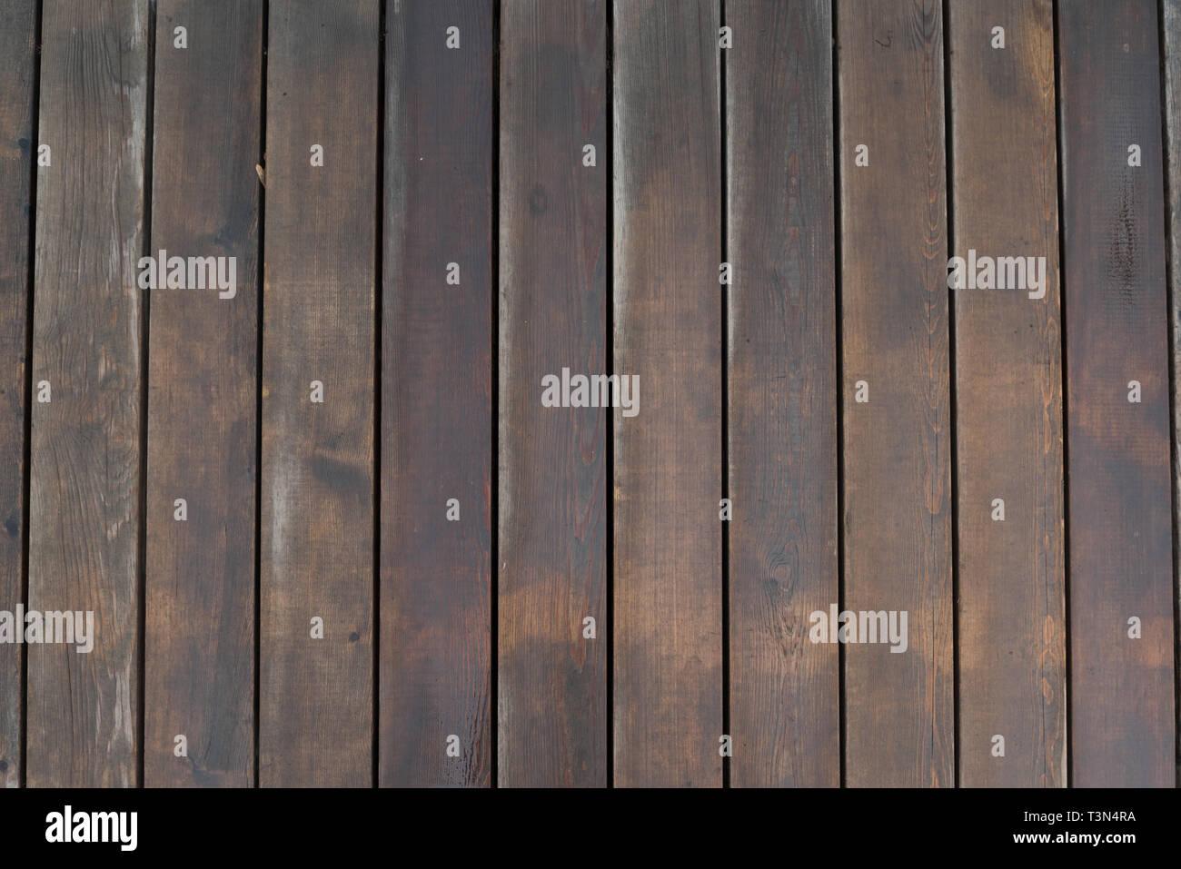 Background of wet wooden boards. Textured floor on top view. - Stock Image