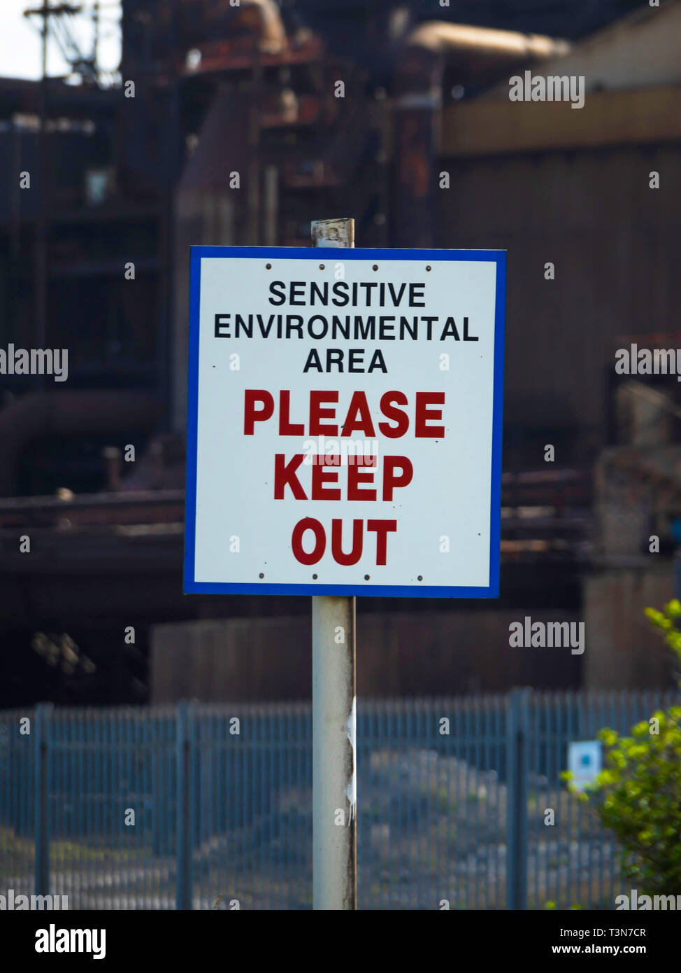 A warning sign for a Sensitive Environmental Area Please Keep Out   erected outside the now disused steel making blast furnace plant in Redcar  North  Stock Photo