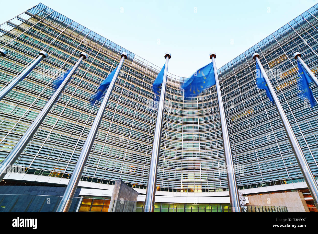 European Union EU flags waving in front of the Berlaymont building, headquarters of the European Commission in Brussels. - Stock Image