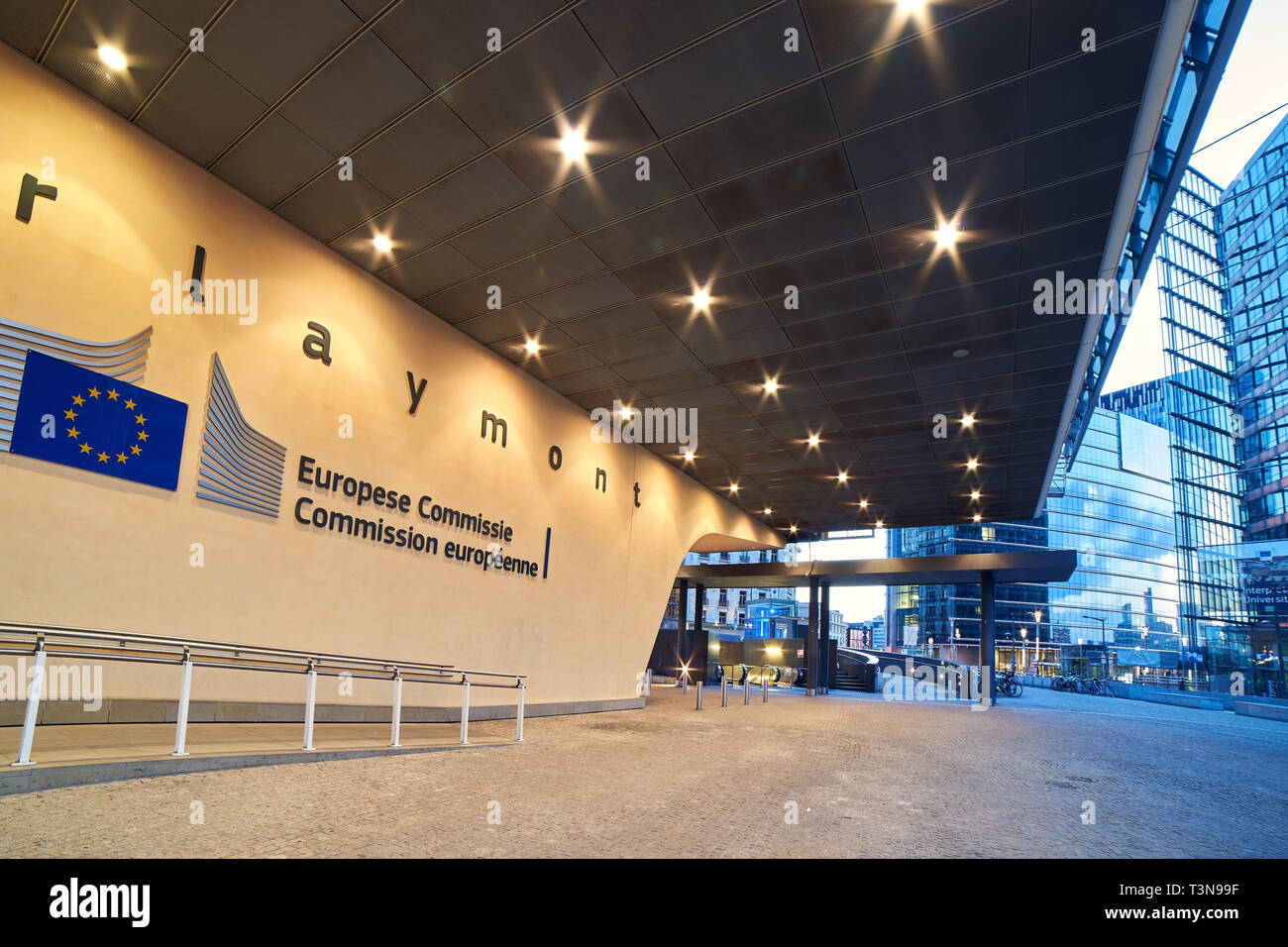 Entrance of the Berlaymont building, headquarters of the European Commission with the organization logo. - Stock Image