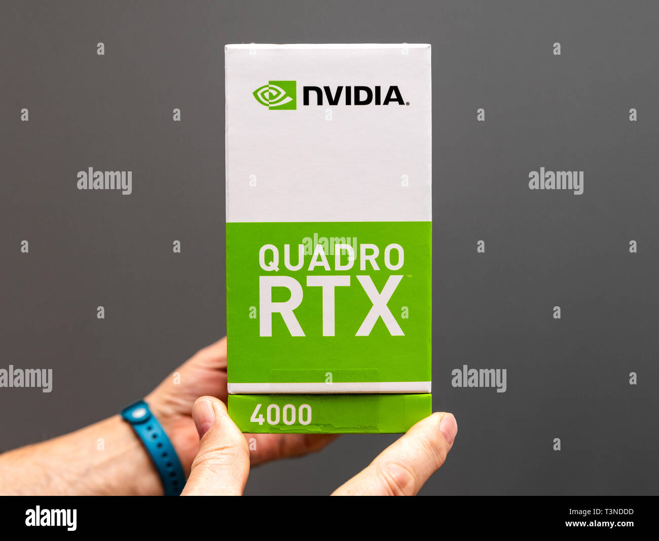 Paris France - Mar 28 2019: Senior man showing cardboard boxes before unboxing of Nvidia Quadro RTX 4000 workstation GPU best features for CGi and architects - Stock Image