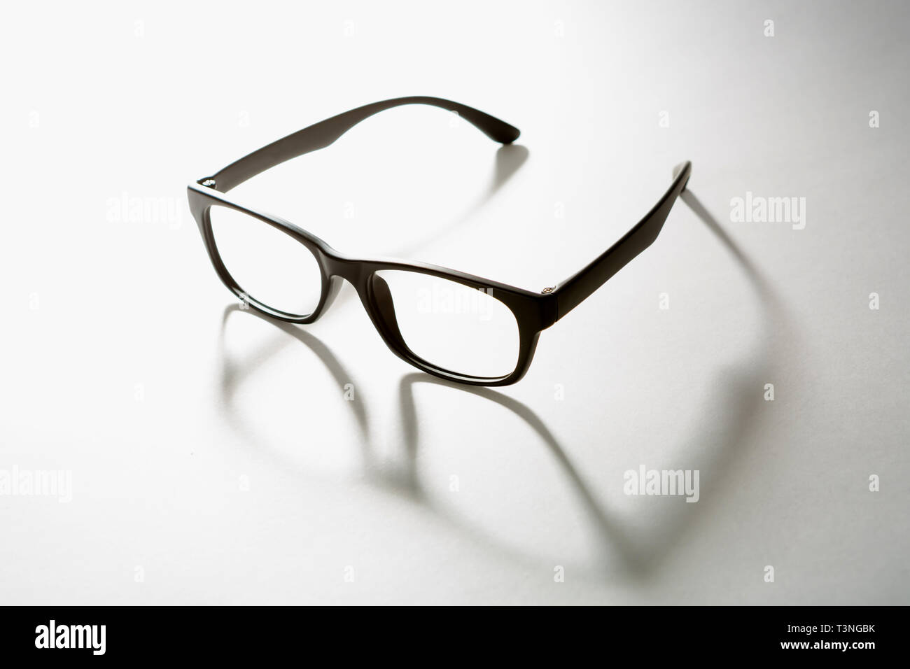 black rimmed glasses. the shadow of one's glasses. - Stock Image